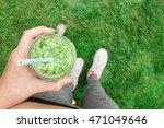 young girl drinking fruit... | Shutterstock . vector #471049646