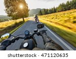 Small photo of Motorcycle drivers riding on motorway in beautiful sunset light. Shot from pillion driver view