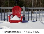 A Snow Covered Red Lawn Chair...
