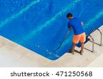 a man cleans the swimming pool. ... | Shutterstock . vector #471250568