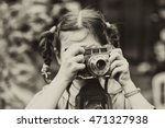 Portrait Of A Little Girl With...
