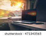 Working While Traveling. Laptop Computer on a Camper Table with Scenic Fjords View. Computer Working in the RV While Camping. - stock photo