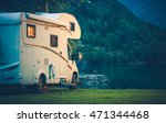 Camper Camping at the Glacier Lake. Camper Van Vacation. - stock photo
