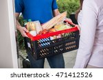 close up of man delivers crate... | Shutterstock . vector #471412526