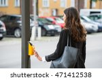 Young Businesswoman Pressing...