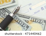 Small photo of Blank Bank Check with Money and Pen.