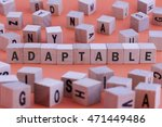 Small photo of ADAPTABLE word on wooden cube isolated on orange background