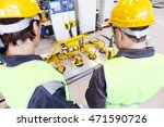 workers near metal sheet... | Shutterstock . vector #471590726