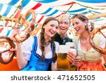 Three Friends In Beer Tent At...