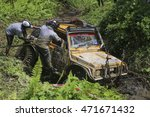 Small photo of SABAH, MALAYSIA - 16 August 2016 : Competitor car capsize in mud during off road challenge in Borneo Safari 2015.