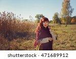 beautiful girl outdoors in... | Shutterstock . vector #471689912