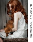 fox and girl with ginger hair | Shutterstock . vector #471701978