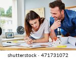 two architects working at their ... | Shutterstock . vector #471731072