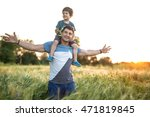 son sits on the shoulders of... | Shutterstock . vector #471819845
