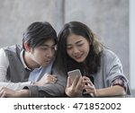 asian younger man and woman... | Shutterstock . vector #471852002