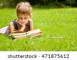 little schoolgirl is reading a... | Shutterstock . vector #471875612