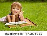 little schoolgirl is reading a... | Shutterstock . vector #471875732