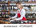 Saleswoman Arranging Wine...