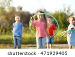 happy kids playing in park | Shutterstock . vector #471929405