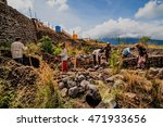 Small photo of BALI,INDONESIA-AUGUST 14, 2016:The eruption of Mount Batur Volcano in 1999-2000 sent down tons of ash.Able-bodied laborers mine the valuable ash for the construction industry in Bali on August 14,2016