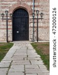 Small photo of PITSUNDA, ABKHAZIA - SEPTEMBER 11, 2010: Door to the temple of Pitsunda in Abkhazia.