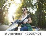 girl tourist with scooter in... | Shutterstock . vector #472057405