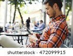 attractive man sitting in cafe... | Shutterstock . vector #472099915
