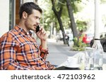 handsome man calling with a...   Shutterstock . vector #472103962