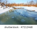Frozen river. Melt in spring - threat of the flood. Natural disaster - stock photo