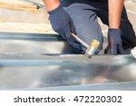 roofer builder worker finishing ...   Shutterstock . vector #472220302