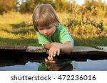 Boy Play With Autumn Leaf Ship...
