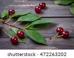 fresh cherries in bowl on table.... | Shutterstock . vector #472263202