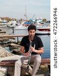 Small photo of ISTANBUL, TURKEY - SEPTEMBER 16: Famous Turkish musician, academician and clarinetist Serkan Cagri portrait on September 16, 2013 in Istanbul, Turkey.