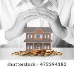 holding house representing home ... | Shutterstock . vector #472394182
