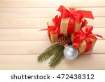 gift boxes on wooden background | Shutterstock . vector #472438312
