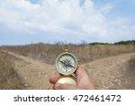 man holding a compass on a fork ... | Shutterstock . vector #472461472