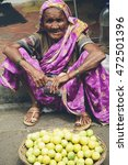 Small photo of MUMBAI, INDIA - OCTOBER 10, 2015: Unidentified woman on the street of Mumbai. With 12 million people, Mumbai is the most populous city in India and the 9th most populous agglomeration in the world.