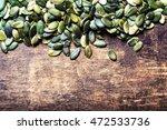 pumpkin seeds over wood... | Shutterstock . vector #472533736