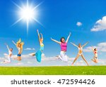 pure joy jumping together  | Shutterstock . vector #472594426