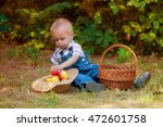 little boy with a basket of... | Shutterstock . vector #472601758