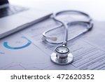 a medical stethoscope near a... | Shutterstock . vector #472620352
