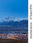 Small photo of Village inclose mountain a famous landmark in Ganzi, Sichuan, China.