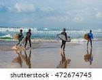 Surfers Walking Down The Banana ...