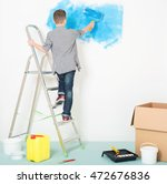 teen boy makes repairs at home. ... | Shutterstock . vector #472676836