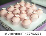 pink cupcakes with flowers on... | Shutterstock . vector #472763236