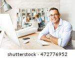 businessman in office | Shutterstock . vector #472776952