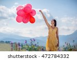 girl playing with red balloons... | Shutterstock . vector #472784332