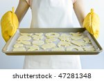 Woman Holding A Cookie Tray...