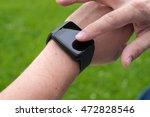 man using smart watch outdoors | Shutterstock . vector #472828546