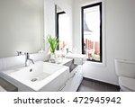 White Washroom Sink And Mirror...